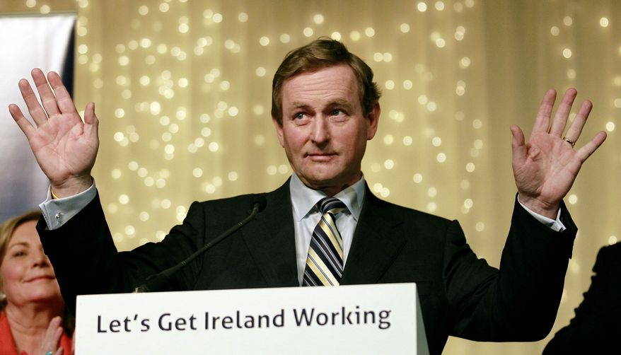 ** File ** Irish Prime Minister Enda Kenny addresses party members at the Burlington Hotel on Dublin on Feb. 26, 2011. (Associated Press)