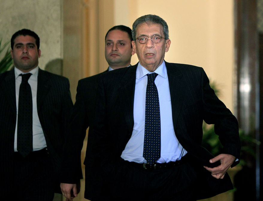 ** FILE ** Arab League Secretary General Amr Moussa (foreground) heads to a press conference on the unrest in Tunisia at the Arab League headquarters in Cairo on Saturday, Jan. 15, 2011.