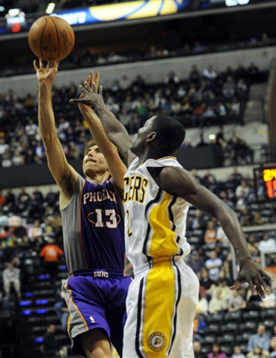 Indiana Pacers guard Darren Collison, right, defends Phoenix Suns guard Steve Nash in first-half NBA basketball game action in Indianapolis, Sunday, Feb. 27, 2011. (AP Photo/Tom Strickland)