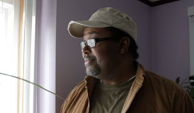 Richard Twiggs, who moved to Southfield 23 years ago, worries that people buying and renting cheap housing in his neighborhood are bringing inner-city problems with them. (Associated Press)
