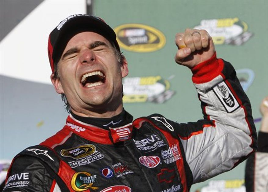 Jeff Gordon celebrates his win in the NASCAR Sprint Cup Series auto race at Phoenix International Raceway on Sunday, Feb. 27, 2011, in Avondale, Ariz. (AP Photo/Ross D. Franklin)