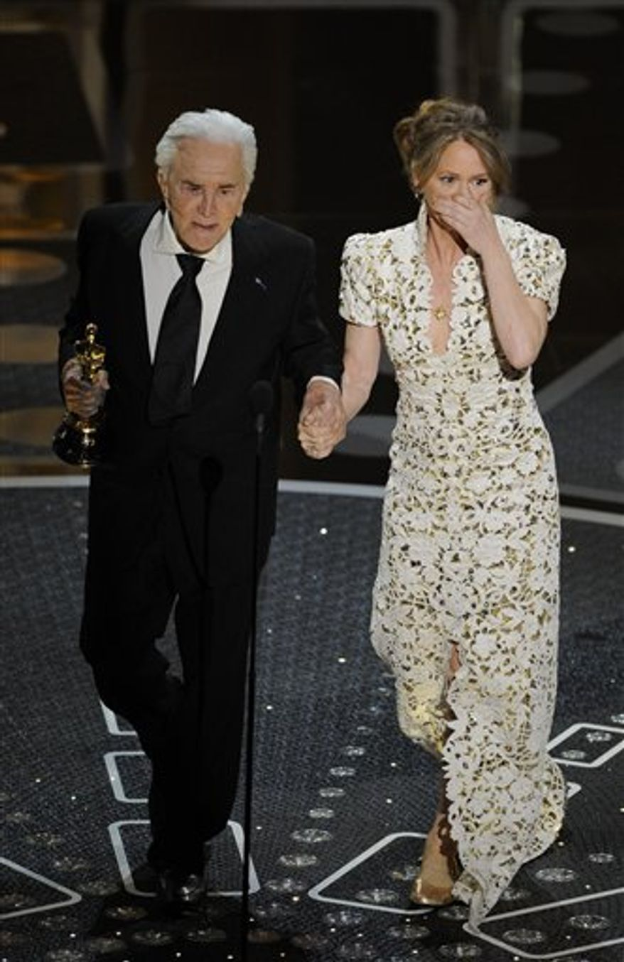 """Kirk Douglas escorts Melissa Leo  after she accepted the Oscar for best actress in a supporting role for """"The Fighter"""" at the 83rd Academy Awards on Sunday, Feb. 27, 2011, in the Hollywood section of Los Angeles. (AP Photo/Mark J. Terrill)"""