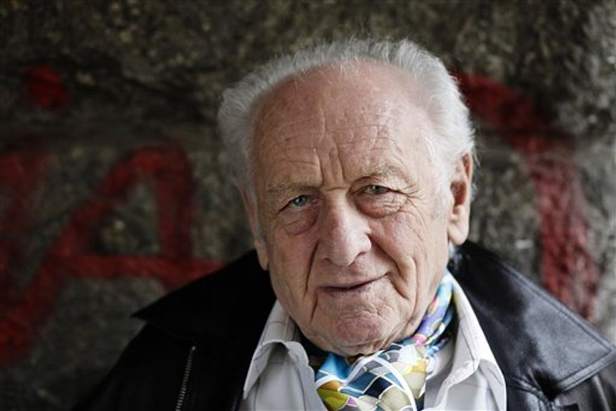 FILE - In this April 17, 2009 file photo, Czech author Arnost Lustig, who escaped from a Nazi death transport to make the Holocaust the main theme of his fiction, poses for a photograph in Prague. Jana Jelinkova, spokeswoman for Prague's Kralovske Vinohrady university clinic says Lustig died early Saturday, Feb. 26, 2011. He was 84. (AP Photo/CTK, Martin Sterba) SLOVAKIA OUT