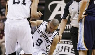 Memphis Grizzlies' Shane Battier, left, and Mike Conley, right, try to strip the ball from San Antonio Spurs' Tony Parker, of France, during the first half of an NBA basketball game, Sunday, Feb. 27, 2011, in San Antonio. (AP Photo/Darren Abate)