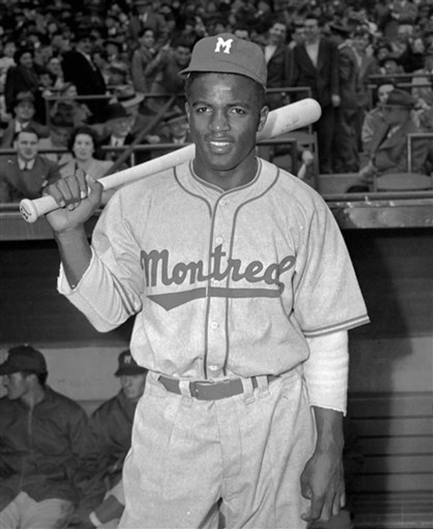 This April 18,1946 file photo shows Montreal Royals Jackie Robinson.  The quaint Montreal duplex that served as sanctuary to the Robinsons during the early part of his career is being recognized by the U.S. government. That chapter in American civil rights will be celebrated Monday, Feb. 28, 2011 when U.S. diplomats unveil a commemorative plaque at the apartment the couple called home in the summer of 1946. (AP Photo/John J. Lent)