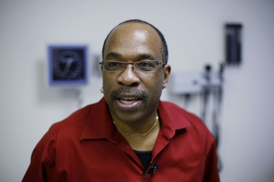 Jay Johnson, who works for an AIDS advocacy and service organization in Philadelphia, took part in one of the studies testing gene therapy as a possible new way to treat and perhaps someday to cure HIV infections. (AP Photo/Matt Rourke)