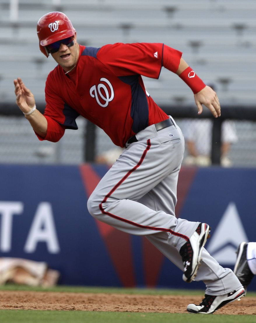 Washington Nationals pinch runner Bryce Harper runs between first and second bases during the fifth inning of a spring training baseball game against the New York Mets, Monday, Feb. 28, 2011, in Port St. Lucie, Fla. (AP Photo/Jeff Roberson)