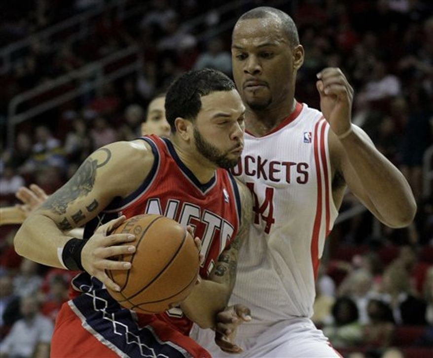 New Jersey Nets' Deron Williams (8) is fouled by Houston Rockets' Kyle Lowry, right, during the first half of an NBA basketball game Saturday, Feb. 26, 2011, in Houston. (AP Photo/Pat Sullivan)