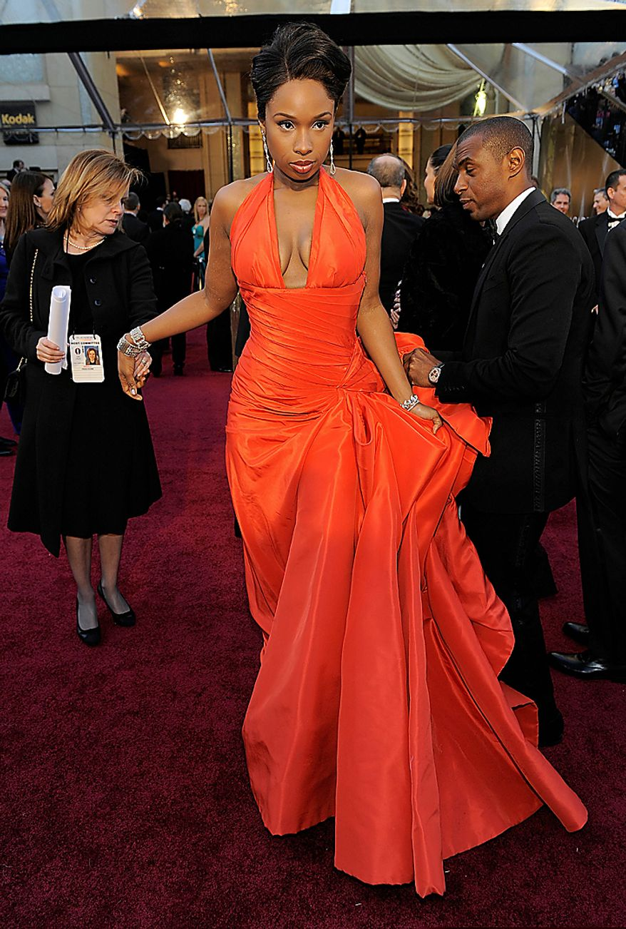 Jennifer Hudson arrives before the 83rd Academy Awards on Sunday, Feb. 27, 2011, in the Hollywood section of Los Angeles. (AP Photo/Chris Pizzello)