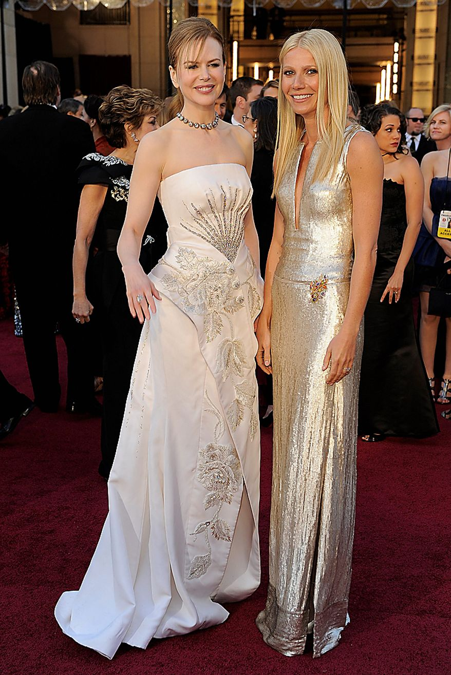 Nicole Kidman poses with Gwyneth Paltrow on the red carpet before the 83rd Academy Awards on Sunday, Feb. 27, 2011, in the Hollywood section of Los Angeles. (AP Photo/Chris Pizzello)