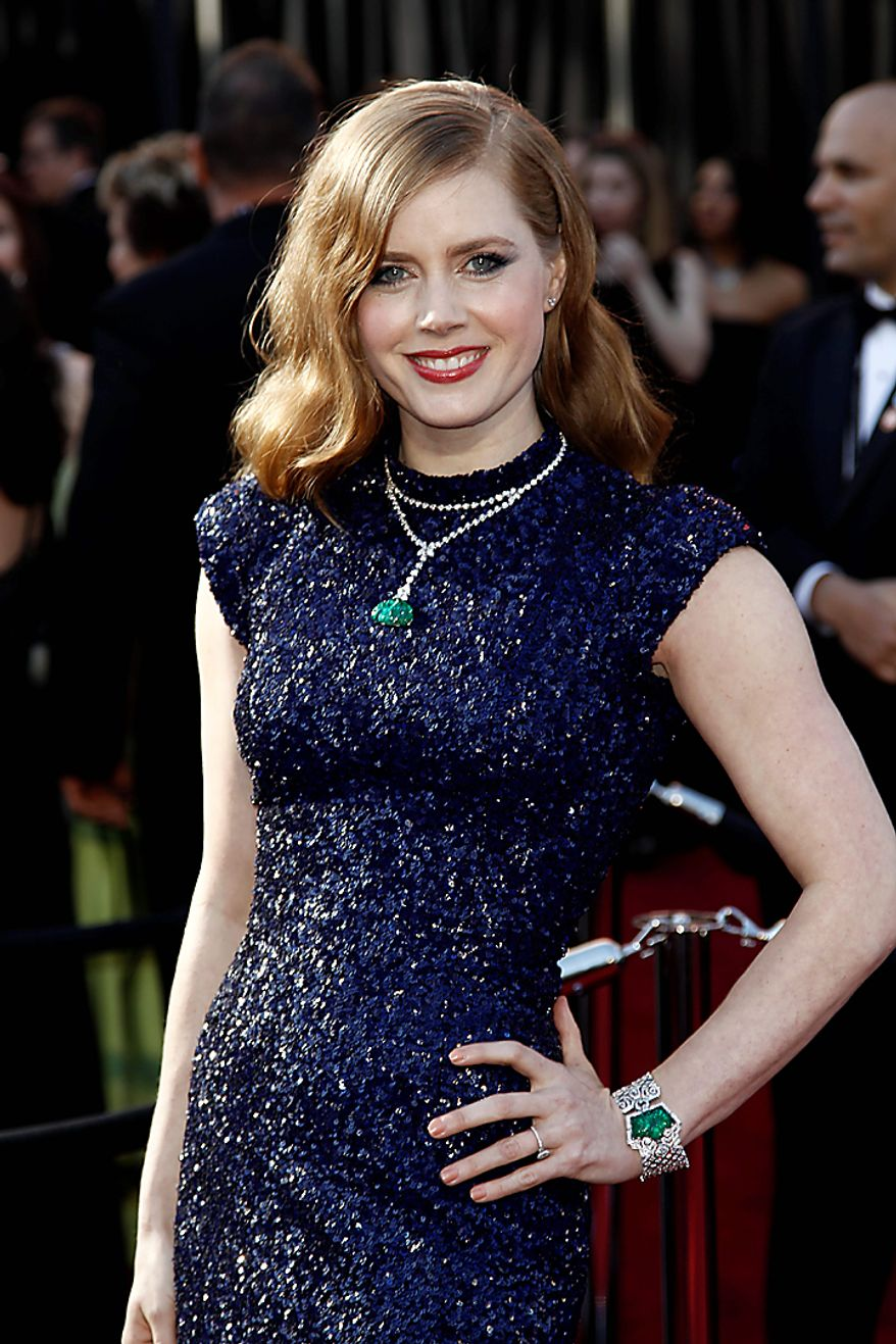 Actress Amy Adams arrives before the 83rd Academy Awards on Sunday, Feb. 27, 2011, in the Hollywood section of Los Angeles. (AP Photo/Matt Sayles)
