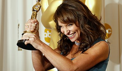 """Susanne Bier, of Denmark, poses backstage with the Oscar for best foreign language film for """"In a Better World"""" at the 83rd Academy Awards on Sunday, Feb. 27, 2011, in the Hollywood section of Los Angeles. (AP Photo/Matt Sayles)"""