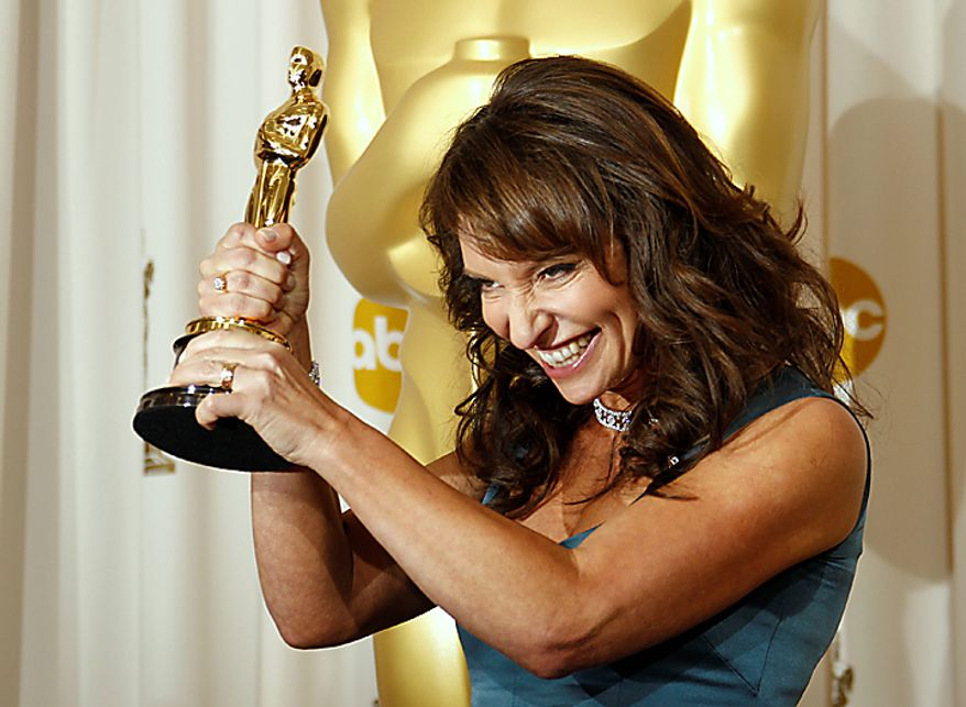 "Susanne Bier, of Denmark, poses backstage with the Oscar for best foreign language film for ""In a Better World"" at the 83rd Academy Awards on Sunday, Feb. 27, 2011, in the Hollywood section of Los Angeles. (AP Photo/Matt Sayles)"