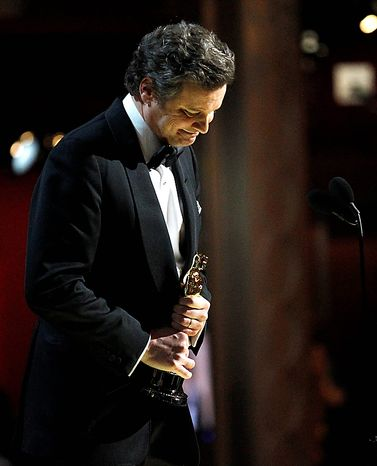"""Colin Firth accepts the Oscar for best performance by an actor in a leading role for """"The King's Speech"""" at the 83rd Academy Awards on Sunday, Feb. 27, 2011, in the Hollywood section of Los Angeles. (AP Photo/Chris Carlson)"""