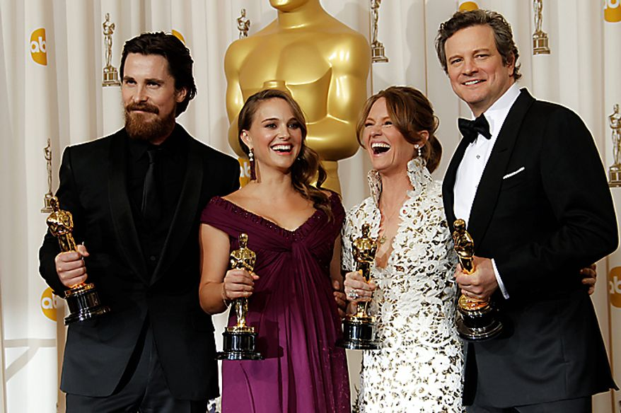 Best supporting actor Christian Bale, left to right, best actress Natalie Portman, best supporting actress Melissa Leo and best actor Colin Firth pose with their awards at the 83rd Academy Awards on Sunday, Feb. 27, 2011, in the Hollywood section of Los Angeles. (AP Photo/Matt Sayles)