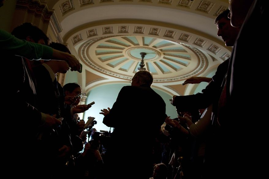 Senate Majority Leader Harry Reid, Nevada Democrat, speaks to reporters after a Democratic policy luncheon on Tuesday in Washington. The Senate is expected to vote Wednesday on a two-week continuing resolution passed Tuesday by the House. (Associated Press)