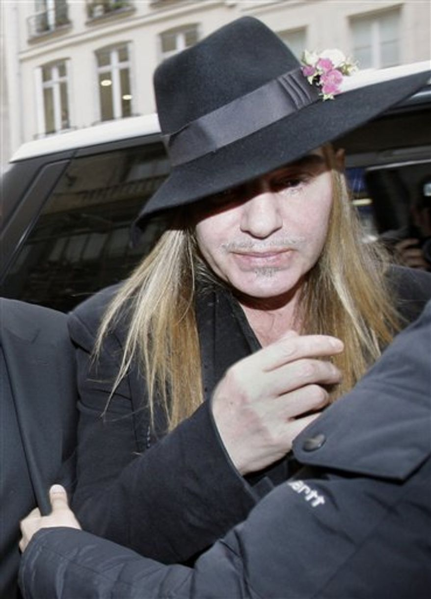 Fashion designer John Galliano arrives at a police station in Paris, Monday, Feb. 28, 2011. Galliano arrived Monday at a Paris police station to face accusations that he made illegal anti-Semitic slurs, hours after a video emerged of the famed fashion designer praising Adolf Hitler. The Gibraltar-born designer, wearing a wide-brimmed black hat, made no comment to reporters as he entered to face claims by a couple that he made an anti-Semitic remark during a dispute at a trendy Paris cafe. (AP Photo/Michel Euler)