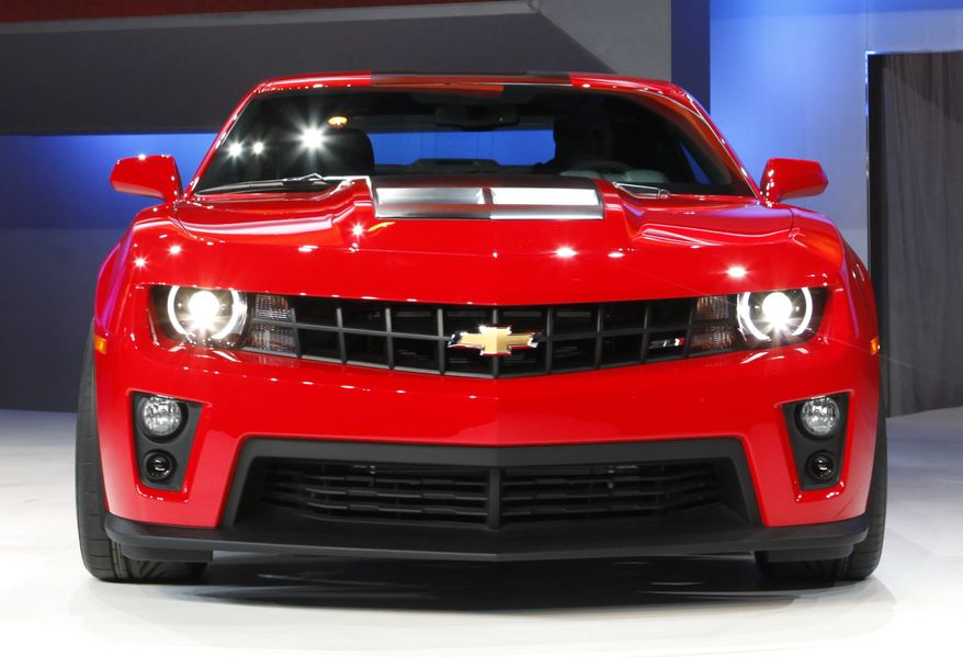 The new Chevrolet Camaro ZL1 is on display at the Chicago Auto Show on Wednesday, Feb. 9, 2011, in Chicago. General Motors' U.S. car and truck sales jumped 49 percent in February, aided by sweeter financing and lease deals. (AP Photo/Charles Rex Arbogast)