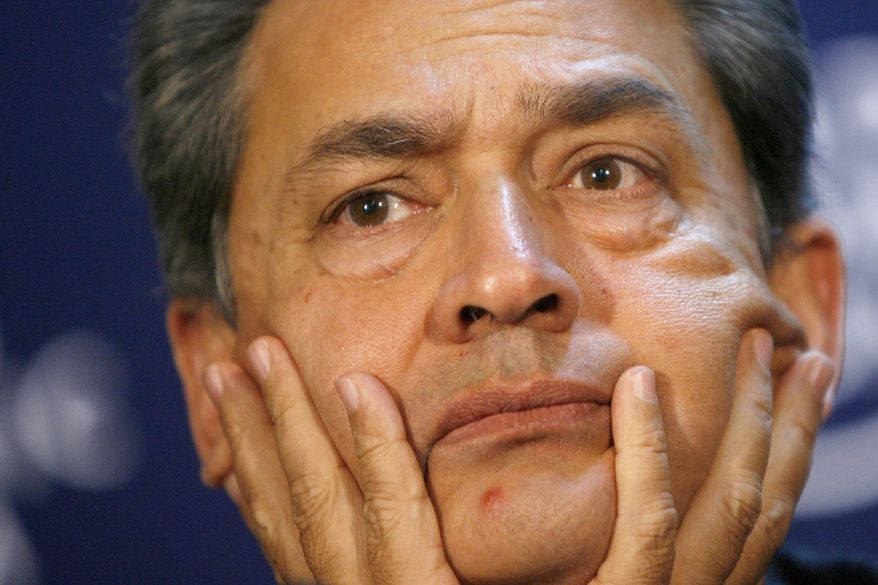 ** FILE ** Rajat Gupta, chairman of the Global Fund to Fight AIDS, Tuberculosis and Malaria, listens to a statement during a session at the World Economic Forum in Davos, Switzerland, in June 2009. Federal regulators on Tuesday, March 1, 2011, charged Mr. Gupta, a former Goldman Sachs board member, with insider trading. (AP Photo/Keystone/Alessandro Della Bella, File)