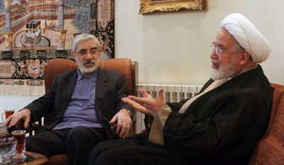 ** FILE ** Mahdi Karroubi (right) and Mir Hossein Mousavi, leaders of the Iranian opposition, talk in Tehran in October 2009. (AP Photo, File)