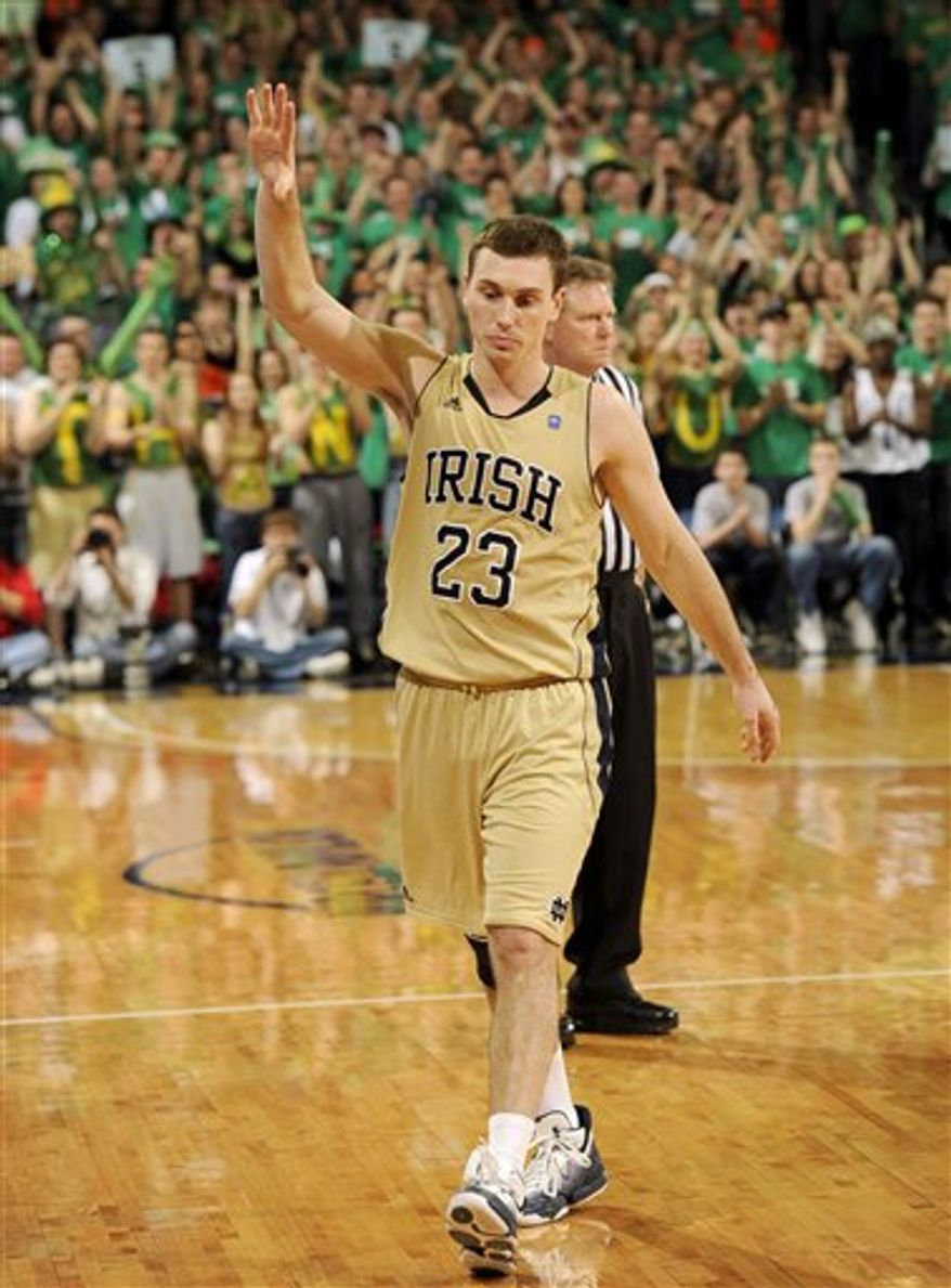 Notre Dame guard Ben Hansbrough, left, jokingly pushes his brother Tyler out of a photo opportunity during senior recognition ceremony prior to the first half of an NCAA college basketball game with Villanova Monday, Feb. 28, 2011 in South Bend, Ind. At left, is Tammy Hansbrough, Ben and Tyler's mother. (AP Photo/Joe Raymond)