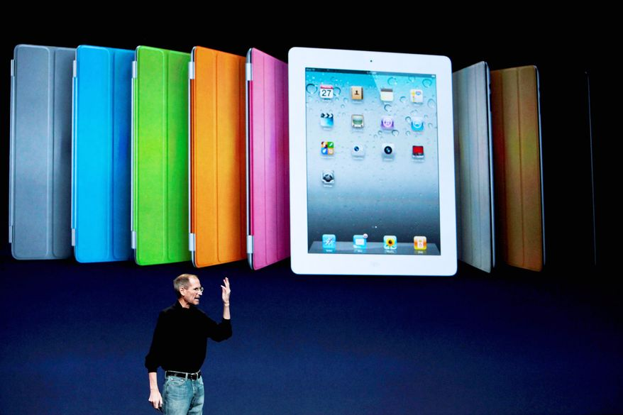 Apple CEO Steve Jobs introduces the iPad 2 in San Francisco on Wednesday. It was his first public appearance since he began medical leave in January, and it prompted a standing ovation. (Bloomberg)
