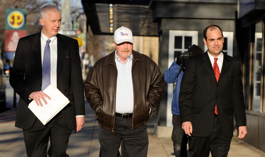 Albert Snyder (center), flanked by his attorneys, walks to a news conference after the Supreme Court's 8-1 ruling in favor of Westboro Baptist Church ended Mr. Snyder's suit against the church for emotional distress after church members marched at the 2006 funeral Mass of Marine Lance Cpl. Matthew Snyder and carried signs with anti-gay, anti-military and anti-Catholic messages. (Associated Press)