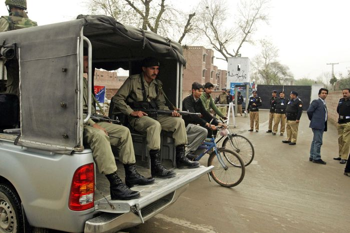 Security is beefed up Thursday outside the central jail in Lahore, Pakistan, where a trial court said it would proceed with the murder trial of CIA contractor Raymond Allen Davis. (Associated Press)