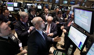 Henry Becker directs trades in shares of MetLife on Thursday at the New York Stock Exchange, where investors watched stocks make substantial gains despite a surge in oil prices because of the turmoil in Libya and neighboring countries. (Associated Press)