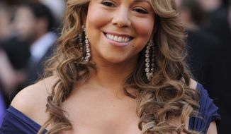 ** FILE ** In this March 7, 2010, file photo, Mariah Carey arrives at the 82nd Academy Awards in the Hollywood section of Los Angeles. Carey's publicist said on Thursday, March 3, 2011, that the entertainer wasn't unaware that a private concert she performed in St. Barts was linked to Moammar Gadhafi's clan -- and she's embarrassed about it. (AP Photo/Chris Pizzello, File)