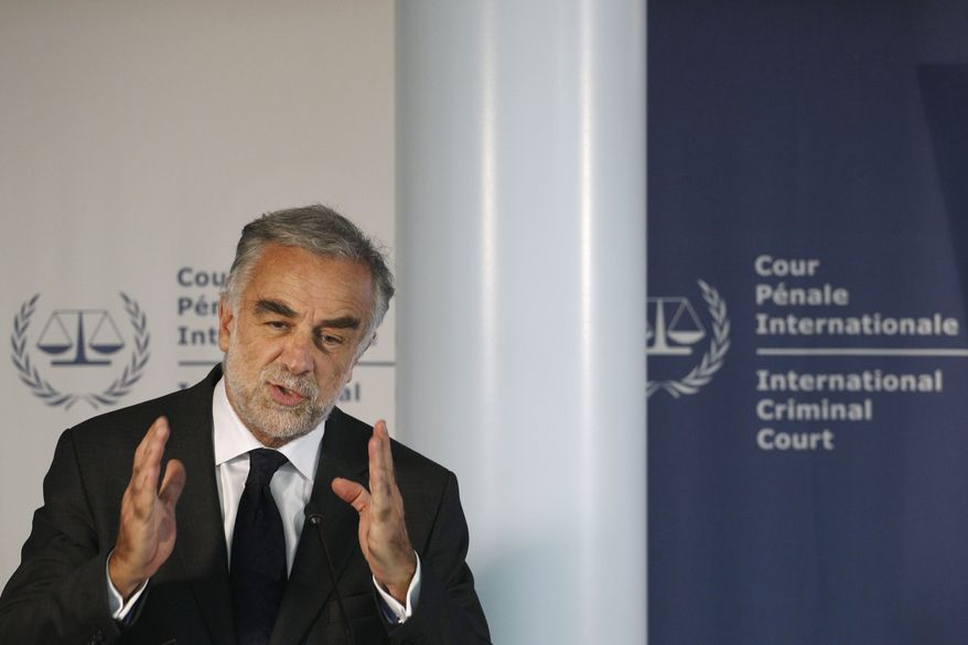International Criminal Court Prosecutor Louis Moreno-Ocampo presents an overview of alleged crimes committed in Libya since Feb. 15 during a press conference at the ICC in The Hague on Thursday, March 3, 2011. Mr. Moreno-Ocampo said he will investigate Col. Moammar Gadhafi and his inner circle, including some of his sons, for possible crimes against humanity in the violent crackdown on anti-government protesters. (AP Photo/Peter Dejong)