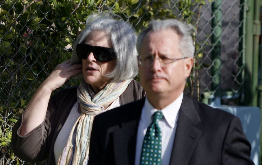 """** FILE ** Judy Gross, wife of U.S. government contractor Alan Gross, and U.S. lawyer Peter J. Kahn arrive at the courthouse where Mr. Gross is on a trial accused of """"acts against the integrity and independence"""" of Cuba, in Havana on Friday, March 4, 2011. (AP Photo/Javier Galeano)"""