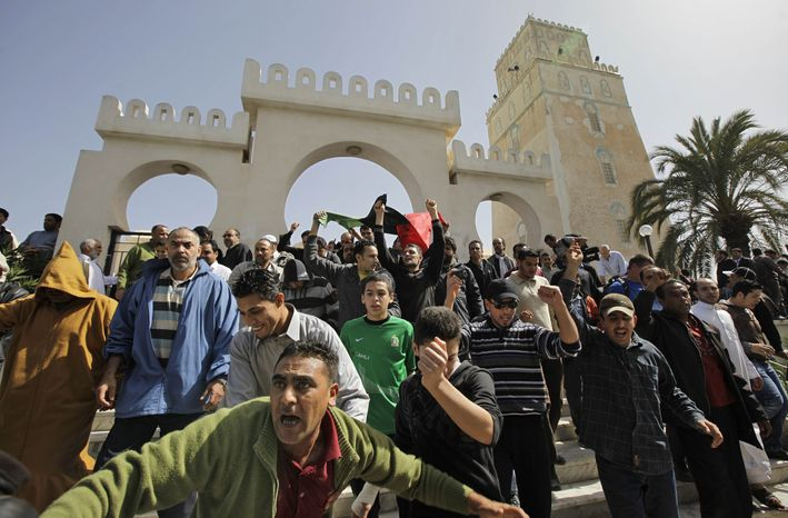 Anti-Gadhafi protesters leave the Muradagha mosque to demonstrate after Friday prayers in the Tajoura district of eastern Tripoli, Libya, Friday, March 4, 2011. Forces loyal to Moammar Gadhafi fired tear gas at protesters who marched in Tripoli on Friday, calling for the Libyan leader's ouster in defiance of a fierce crackdown by regime supporters that has spread fear in the capital. (AP Photo/Ben Curtis)