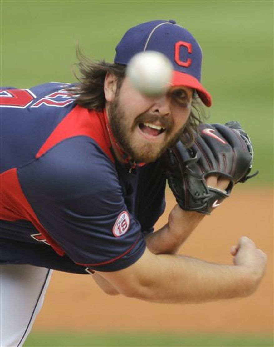 Cleveland Indians' Chris Perez pitches against the Los Angeles Dodgers in the third inning of a spring training baseball game Tuesday, March 1, 2011, in Goodyear, Ariz. (AP Photo/Mark Duncan)