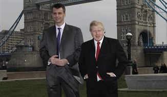 The owner of the New Jersey Nets basketball team, Russian businessman Mikhail Prokhorov, center left, poses for photographs with London mayor Boris Johnson, center right, and Russian dancers backdropped by Tower Bridge outside City Hall in London, Friday, March 4, 2011. The New Jersey Nets are playing the Toronto Raptors in London this weekend in the NBA's first ever regular season games to be held in Europe.  (AP Photo/Matt Dunham)