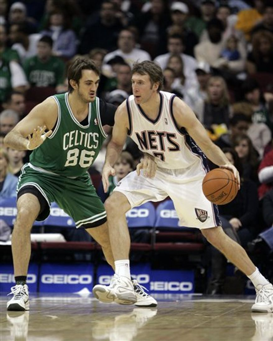 FILE - In this file photo taken Dec. 5, 2010, New Jersey Nets' Troy Murphy (7) moves with the ball as Boston Celtics' Semih Erden (86), of Turkey, defends in the second half of an NBA basketball game in Newark, N.J. Murphy, a free-agent, decided to join the Boston Celtics over the Miami Heat, ESPN.com reported Tuesday, Mar. 1, 2011. Murphy was traded from the Nets to the Golden State Warriors last week, but was then bought out of his contract. (AP Photo/Rich Schultz, File)