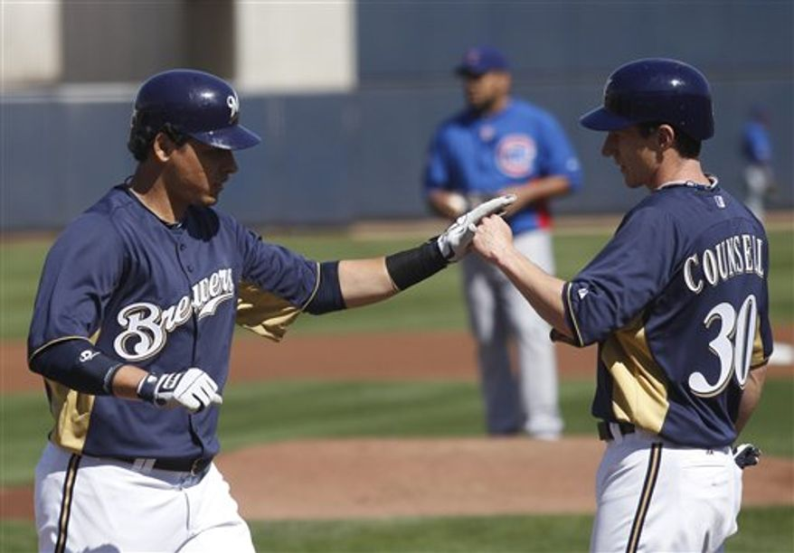 Chicago Cubs third baseman Aramis Ramirez cannot handle a ball hit by Milwaukee Brewers' Brandon Boggs during the third inning of spring training baseball game on Wednesday, March 2, 2011, in Phoenix. (AP Photo/Morry Gash)