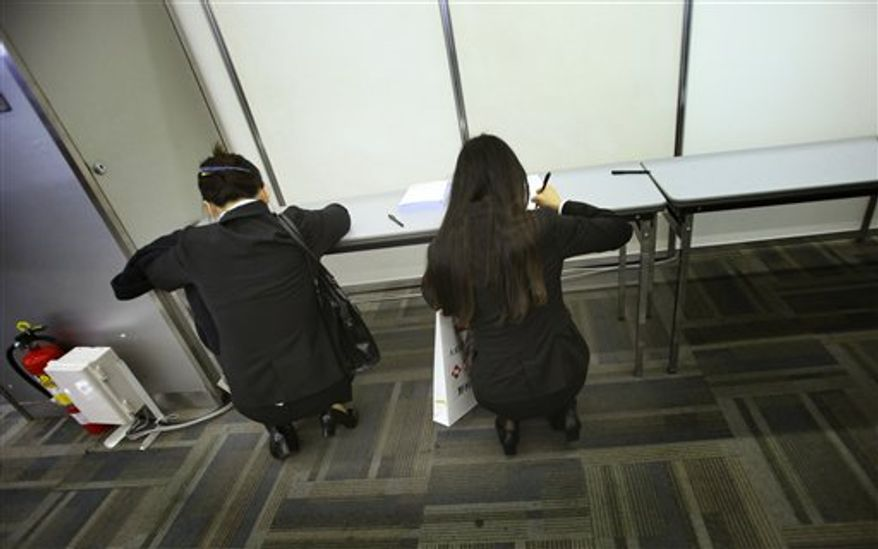 FILE - In this Jan. 22, 2011 file photo, new graduates fill out forms after attending a company's briefing session as they look for a job in Tokyo. The National Police Agency report published Thursday, March 3, 2011 says a total of 31,690 people committed suicide in 2010, fell from the year before but remained above 30,000 for the 13th year in a row. But the number of people citing grim job prospects in their suicide notes has more than doubled since 2007. About one-third of them were in their 20s, including new graduates seeking jobs. (AP Photo/Junji Kurokawa, FILE)