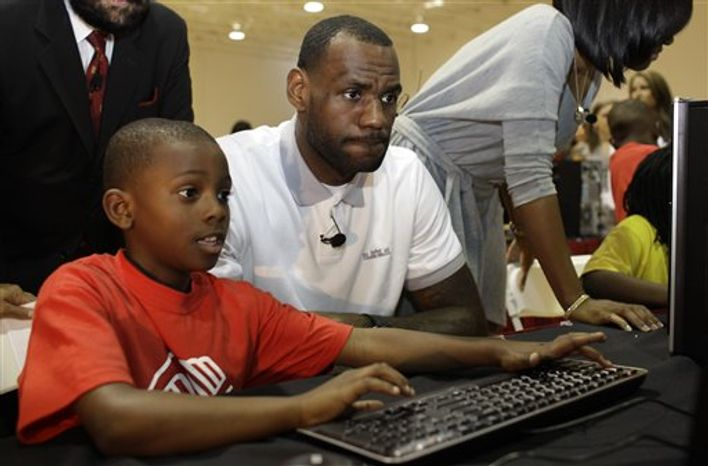 Miami Heat basketball player LeBron James, right, sits with his girlfriend Savannah Brinson during a charity event at the Northwest Boys & Girls Club in Miami, Wednesday, March 2, 2011. The LeBron James Family Foundation partnered with HP to donate 1,000 computers nationwide to Boys & Girls Clubs of America. (AP Photo/Lynne Sladky)