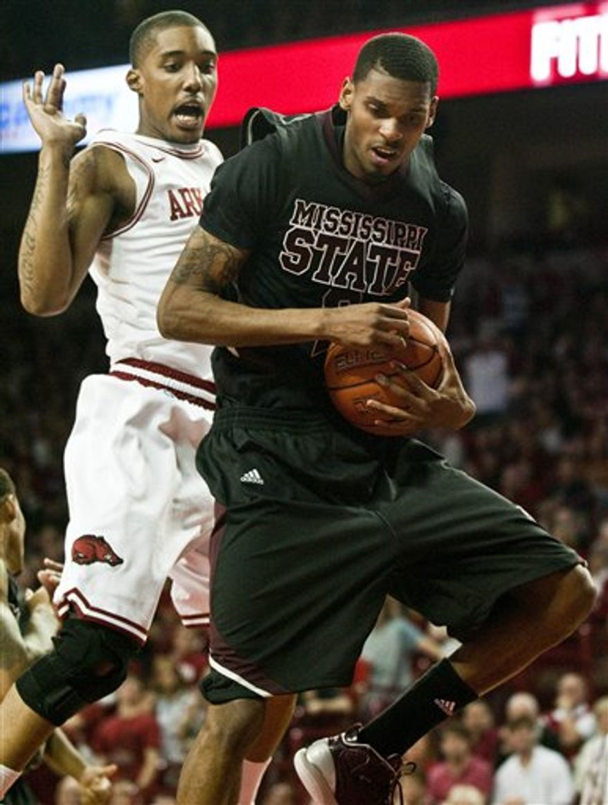 Mississippi State's Ravern Johnson, right, grabs a rebound as Arkansas' Jemal Farmer (2) defends during the first half of an NCAA college basketball game in Fayetteville, Ark., Wednesday, March 2, 2011. Johnson scored a team-high 25 points as Mississippi State defeated Arkansas 88-78. (AP Photo/April L. Brown)