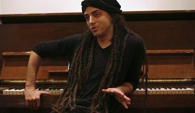 FILE - In this March 5, 2009 file photo, Israeli musician Idan Raichel is interviewed before a performance in Jerusalem. (AP Photo/Dan Balilty, file)