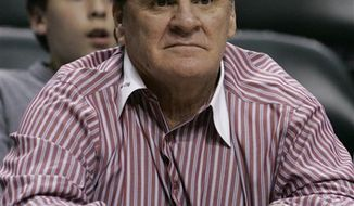 FILE - In this Feb. 10, 2009, file photo, former baseball player Pete Rose watches an NBA basketball game between the Indiana Pacers and the Cleveland Cavaliers in Indianapolis. Court records show Rose has filed for divorce from his wife of nearly 27 years, Carol. The 69-year-old Rose cited irreconcilable differences for the split, but his petition did not offer any additional details. A phone message left for his attorney, Joseph Mannis, was not immediately returned. (AP Photo/Darron Cummings, File)