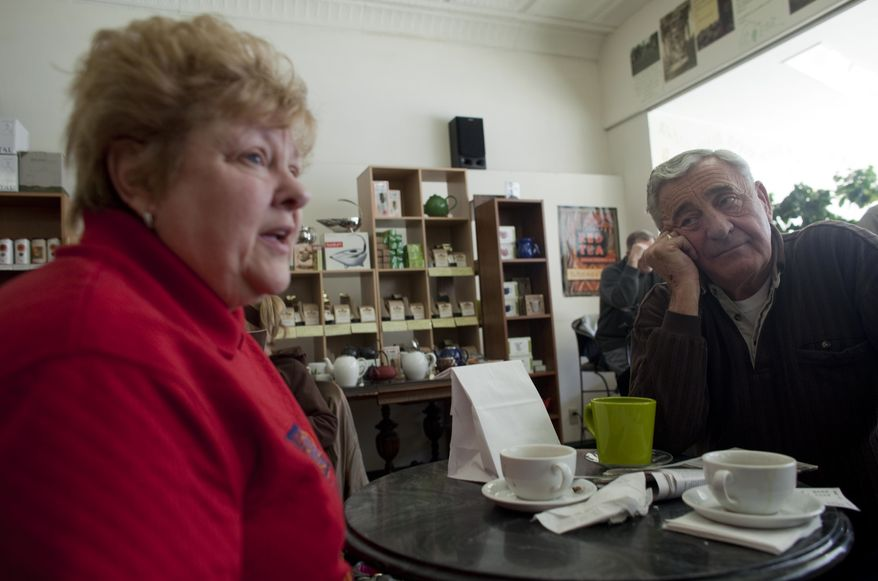 In this March 2, 2011, photo, Nancy, left, and her husband Harry Harrington talk about the Wisconsin budget crisis at Wilson's Coffee & Tea in Racine, Wis. Harry now blames years of union demands for an exodus of manufacturing jobs from this blue-collar city on the shore of Lake Michigan. (AP Photo/Darren Hauck)