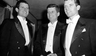 ** FILE ** This March 15, 1958, file photo shows then-Sen. John F. Kennedy, center, D-Mass., and his brothers Edward Kennedy, left, a student at the University of Virginia, and Robert F. Kennedy, chief counsel to the Senate Rackets Committee, at the annual Gridiron Club dinner in Washington, D.C. (Associated Press)