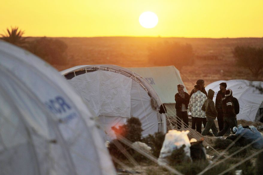 People who worked in Libya but fled the emerging civil war there can only wait and hope for better days Sunday in a refugee camp at the Tunisia-Libyan border in Ras Ajdir, Tunisia. It can shelter about 5,000. (Associated Press)