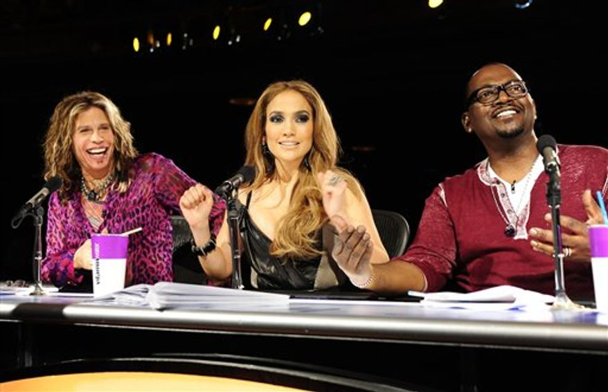"""FILE - In this undated file publicity image released by Fox, """"American Idol"""" judges, from left, Steven Tyler, Jennifer Lopez and Randy Jackson are shown during Hollywood Week in Los Angeles. The Hollywood stage became a little less crowded Thursday, March 3, 2011, as """"American Idol"""" cut its contestant pool from 24 to a lucky 13 finalists. (AP Photo/Fox, Michael Becker)"""