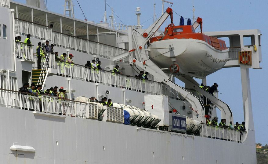 Bangladeshis evacuated from Libya are seen on the deck of the ferry Ionian King, docked at the port of Souda on the Greek island of Crete on Sunday, March 6, 2011. (AP Photo/Image Photo Services)