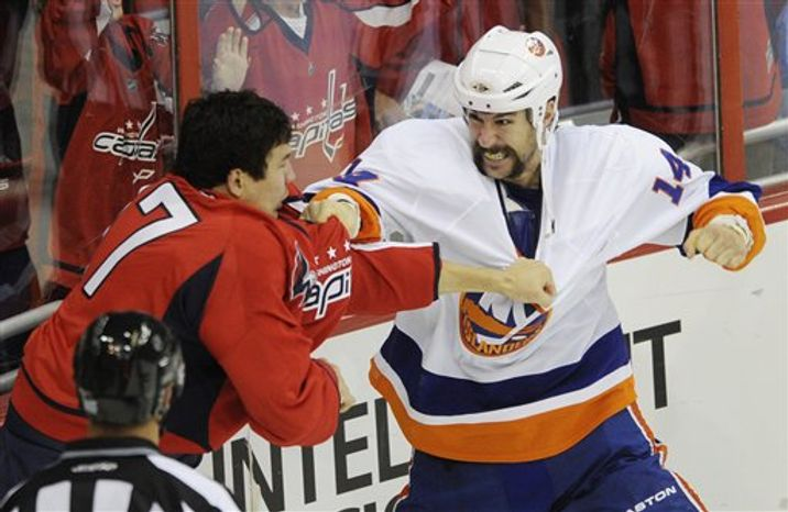 FILE - This Oct. 13, 2010, file photo shows Washington Capitals right wing D.J. King (17) fighting with New York Islanders left wing Trevor Gillies (14) during the first period of an NHL hockey game, in Washington. Gillies has been hit hard by the NHL again, getting a 10-game ban Friday, March 4, 2011, for a dangerous shot from behind in his first game back from a nine-game suspension. (AP Photo/Nick Wass, File)