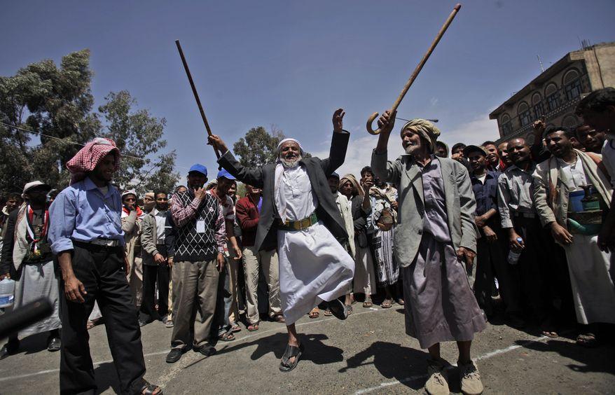 Two elderly anti-government protesters dance during a demonstration demanding the resignation of Yemeni President Ali Abdullah Saleh in Sanaa, Yemen, on Sunday, March 6, 2011. (AP Photo/Muhammed Muheisen)