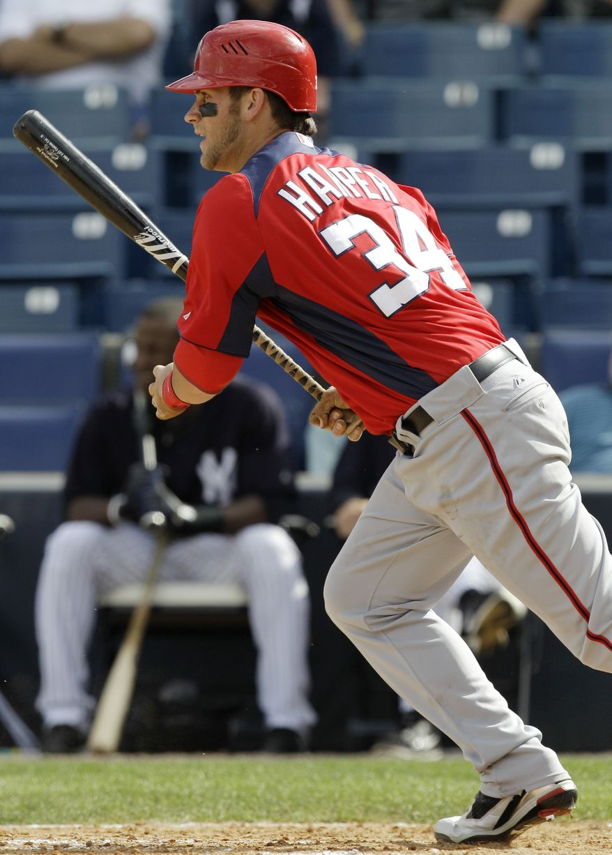 Washington Nationals right fielder Bryce Harper (34) grounds out in the seventh inning of the Nationals 10-8 victory over the New York Yankees in their spring training baseball game at Steinbrenner Field in Tampa, Fla., Saturday, March 5, 2011. Harper was one for two in the game. He had an eighth inning single. (AP Photo/Kathy Willens)